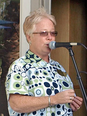Debra singing at the party